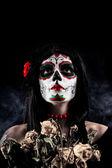 Sugar skull girl with dead roses — Stock Photo