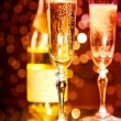 Champagne glasses and bottle — Stock Photo