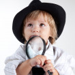 Young detective with magnifying glass — Stock Photo