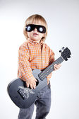 Cute little boy with ukulele guitar — Stock Photo