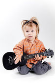 Cute little boy playing ukulele guitar — Stockfoto
