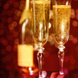 Elegant champagne glasses and bottle — Stock Photo