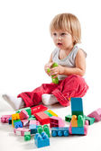 Cute little boy playing with colorful blocks — Stock Photo