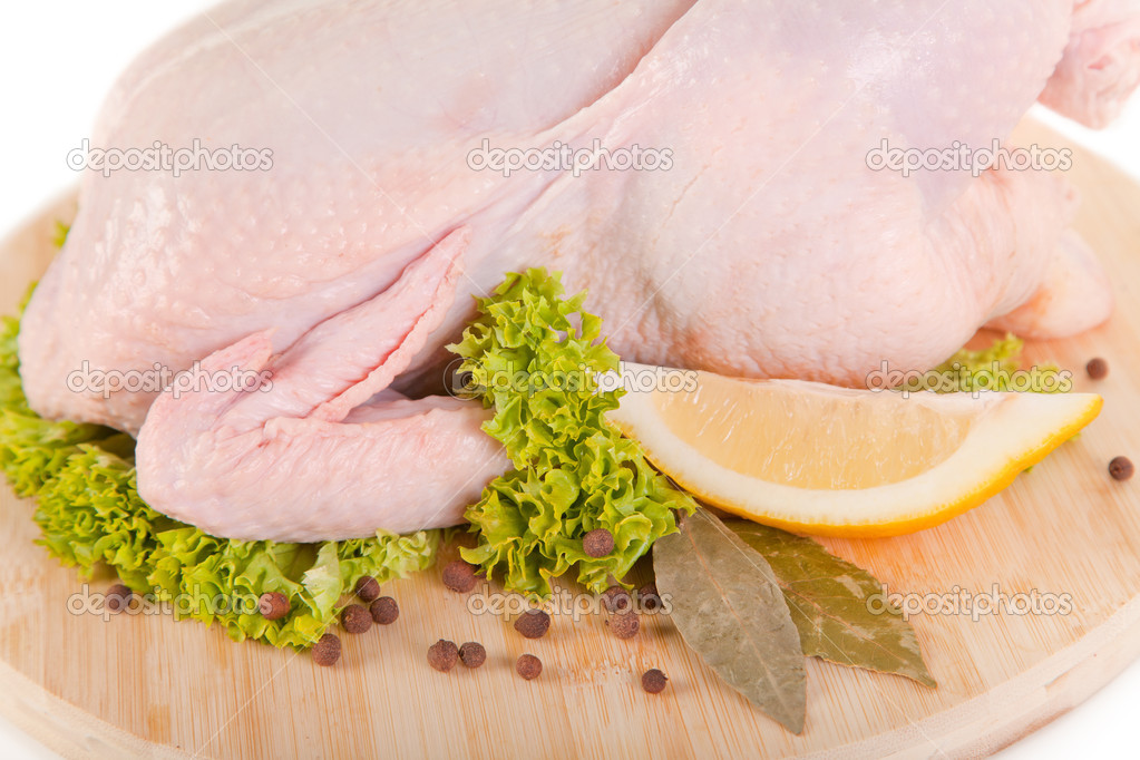 Close-up shot of fresh raw chicken with condiments and lemon  — Stock Photo #5349227