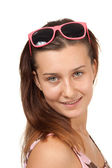 Portrait of a young girl in pink glasses — Stockfoto