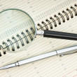 Pen and magnifying glass - Stockfoto