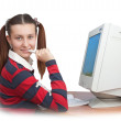 Teen girl and a computer — Stock Photo