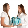 Young girls and a box with a gift — Stock Photo
