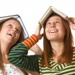 Stock Photo: Two teenage girls fool around