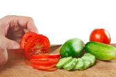 Chop tomatoes and cucumbers — Stok fotoğraf