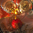 Стоковое фото: Glasses of wine and Christmas decoration