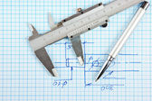 Technical drawing and callipers with pen — Stock Photo