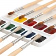 Watercolor paints and  brushes — Stockfoto