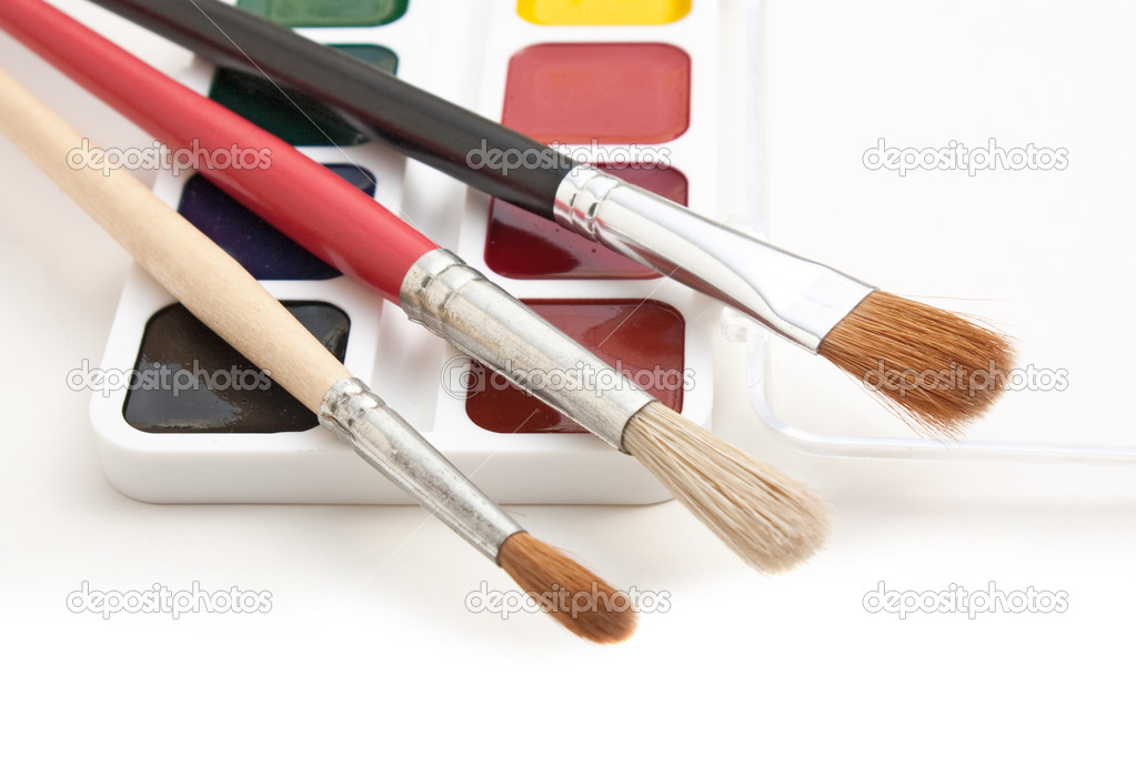 Watercolor paints and  brushes isolated on a white  background — Stock Photo #4927335