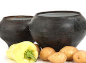 Cast iron pot with vegetables — Stock Photo