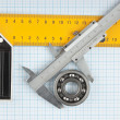 Setsquare and calliper with bearing - Stock Photo