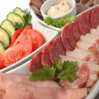 Assorted sausages and vegetables — Stock Photo
