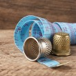Two thimble and measuring tape — Stock Photo