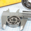 Stock Photo: Setsquare and calliper with bearing