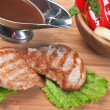 Dishes of roast meat — Stock Photo