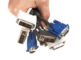 Bunch of computer cables with sockets in hand — Stock Photo