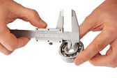 Callipers with bearing in hand — Stock Photo