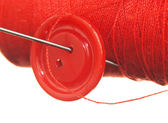 Spool of thread and buttons — Stock Photo