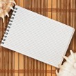 Notebook on the mat — Stock Photo
