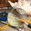 Magnifying glass and a compass — Stock Photo
