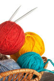 Ball of wool and knitting needles in basket — Stock Photo