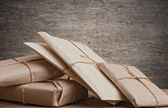 Pile parcels wrapped — Stock Photo