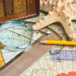 Old map and a loop with a protractor - Stock Photo