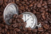 Pocket watch in coffee beans — Stock Photo