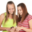 Portrait of lovely young women using mobile phone together — Stock Photo #5326810