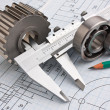 Mechanical drawing and pinion - Stock Photo