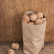 Walnuts in kraft paper bag — Stock Photo #5371842