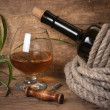 Glass of wine and a bottle — Stock Photo #5371971
