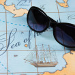 Stock Photo: Sunglasses are on map