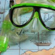 Mask and snorkel diving on map — Stock Photo #5372458