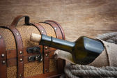 Old chest and bottle — Stock Photo