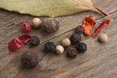 Spices on old wooden table — ストック写真