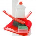 Brush on dustpan with bottles and sponge — Stock Photo