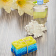 Stock Photo: Soap bath sponge cockle shell bottle and flower