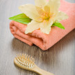 Flower on pink towel with hairbrush — Stock Photo #5062942