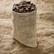 Stock Photo: Coffee grains in bag
