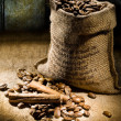 Sack of coffee beans on a background of old boards — Stock Photo #5069866