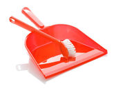 Red plastic dustpan with brush — Stock Photo