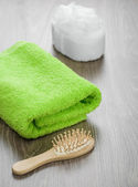 Hairbrush and bath sponge with towel — Stock Photo
