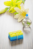 Bath sponge soap flowers and bottle — Stock Photo