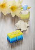 Soap bath sponge cockle shell bottle and flower — Stock Photo